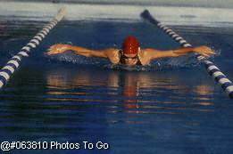Female swimmer in pool doing butterfly